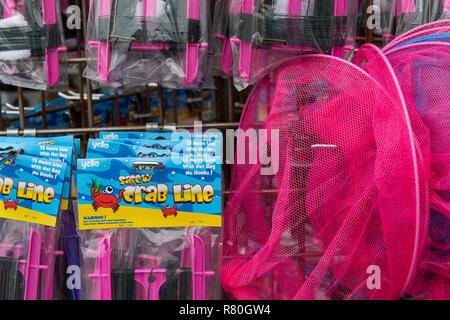Lymington, England - October 25, 2018: Pink crab fishing gear at a shop. - Stock Photo
