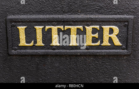 Lymington, England - October 25, 2018: The golden word Litter on a black trash can. - Stock Photo