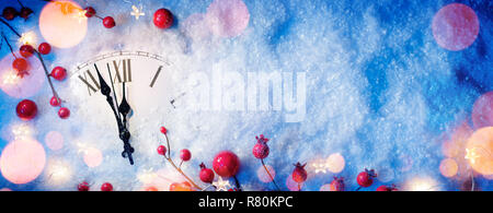 Waiting Midnight - Happy New Year With Clock And Berries On Snow - Stock Photo