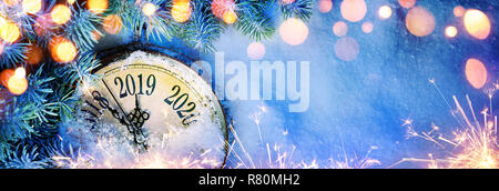 New Year 2019 - Celebration With Dial Clock On Snow And Lights - Stock Photo