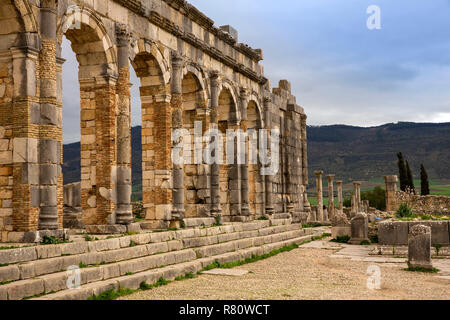 Morocco, Meknes, Volubilis Roman site, arches of the Basilica, law courts and forum - Stock Photo