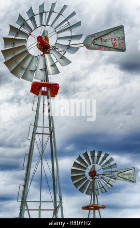 two wind wheels or wind pumps up close - Stock Photo