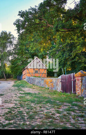 Small brick house in the woods at the cemetery in Benz. Usedom, Germany - Stock Photo