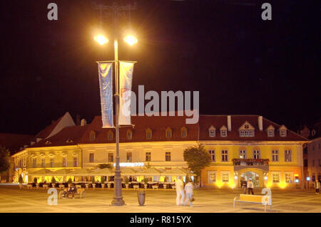 City Hall, left, baroque Jesuit church, right, Main Square, Sibiu, Transylvania, Romania - Stock Photo