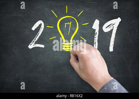New Year 2019 Idea Concepts with Light Bulbs - Stock Photo