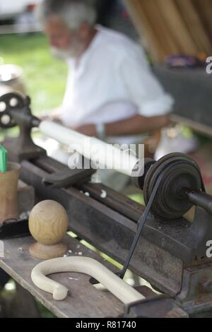 Traditional woodworker at a vintage festival in Wiltshire - Stock Photo