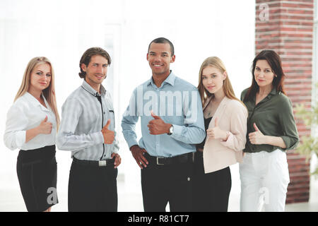 successful multinational business team showing thumb up - Stock Photo