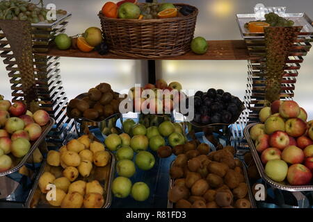 plates with fresh fruit oranges apples pineapple bananas healthy food - Stock Photo
