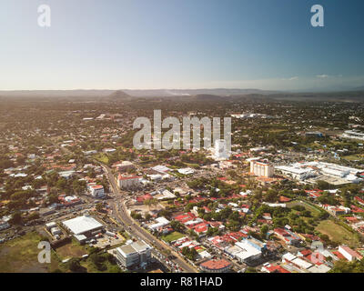 Busy streets in Managua city aerial drone view - Stock Photo