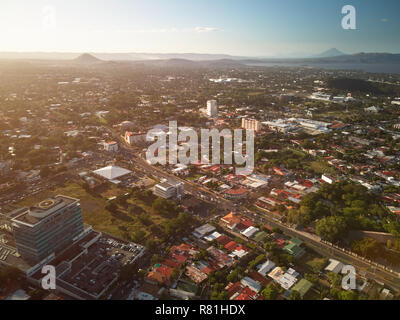 Sunset at Managua city in Nicaragua aerial drone view - Stock Photo