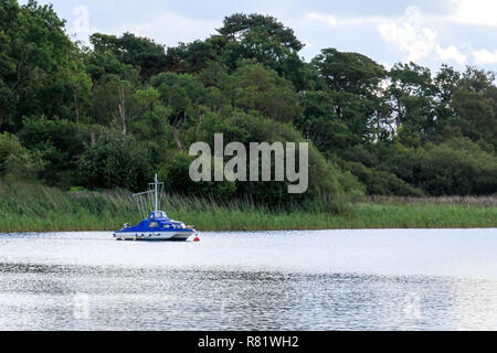 Small boat mored on a Scottish Loch - Stock Photo