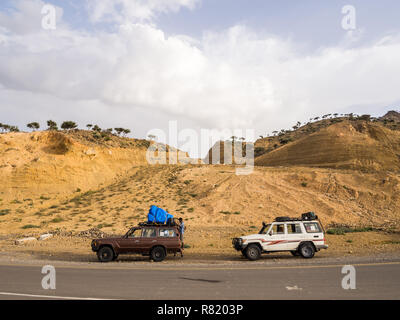 DANAKIL DEPRESSION, ETHIOPIA - JUNE 29, 2016: People traveling in jeeps in Danakil Depression, Ethiopia, the hottest place on Earth. - Stock Photo