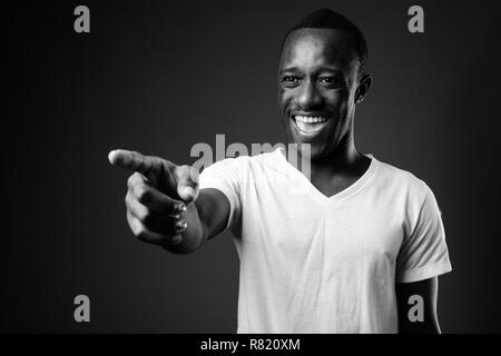 Young African man laughing and pointing finger