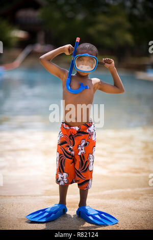 Boy wearing snorkel, mask and flippers - Stock Photo