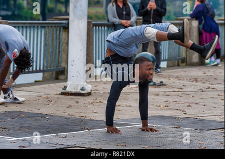 Portland, Oregon,USA - October 8, 2016: A street entertainer does Contortions along the City's waterfront in downtown Portland. - Stock Photo
