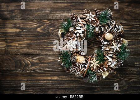 Christmas wreath on dark table top view. - Stock Photo