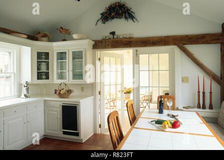 Luxury White Kitchen Interior in the Northeastern United States - Stock Photo
