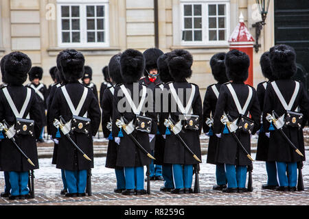 Changing of the guard ceremony in front of the Royal Palace Amalienborg with the Royal Life Guards, Copenhagen - Stock Photo