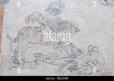 St. George with the Dragon, medieval mural painting, church of Hejdeby, diocese of Visby, island of Gotland, Sweden - Stock Photo