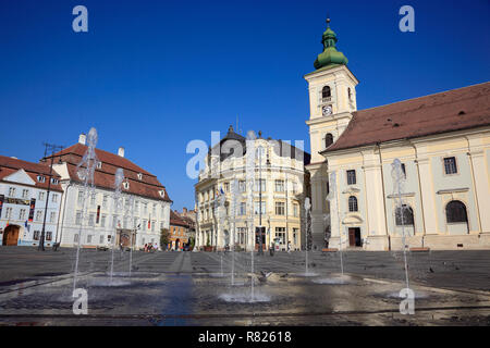 Brukenthal Palace, City Hall and the Catholic Garrison Church on the right, Great Square, Sibiu oder Hermannstadt, Siebenbürgen - Stock Photo