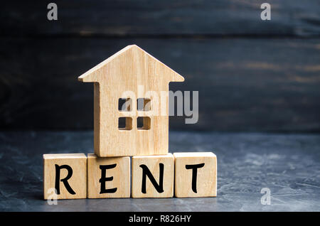Wooden house with the inscription rent. Rental of property, apartments. services of a realtor. affordable housing, rental prices. real estate - Stock Photo