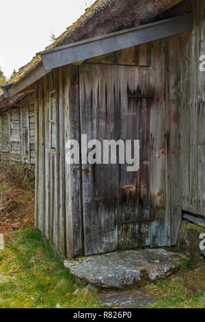 Old outhouse at a barn in the countryside - Stock Photo