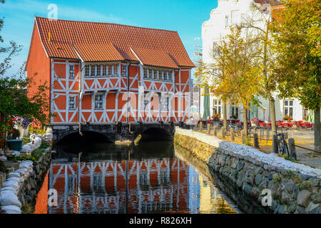 WISMAR/GERMANY - OCTOBER 2018: Historical city center and old houses in Wismar during sunny day during fall - Stock Photo