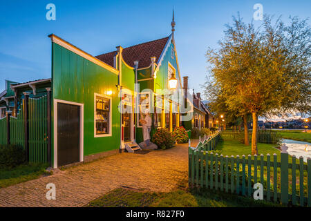 Evening street view on typically traditional Dutch house, windmill, historical architecture and bridge at the Zaanse Schans, Popular touristic landmar - Stock Photo