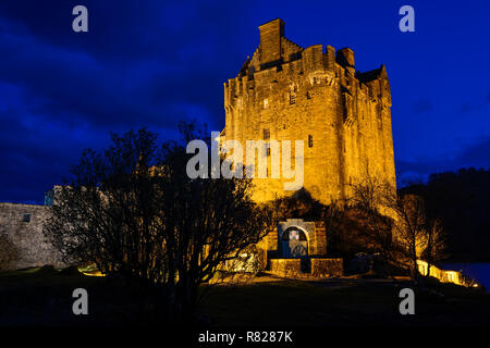 Eilean Donan Castle at twilight on the shore of Loch Duich near Dornie in Wester Ross, Highland Region, Scotland - Stock Photo