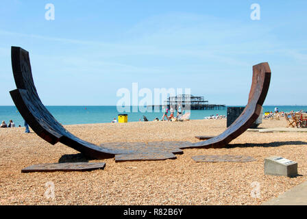Passacaglia recycled cast iron sculpture on Brighton beach, East Sussex, England