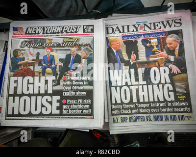 New York, NY/USA- December 12, 2018 Headlines of New York newspapers on Wednesday, December 12, 2018 report on the previous days' contentious meeting between US President Donald Trump and Congressmember Nancy Pelosi and Senator Charles Schumer over the border wall and a government shutdown. (© Richard B. Levine) - Stock Photo