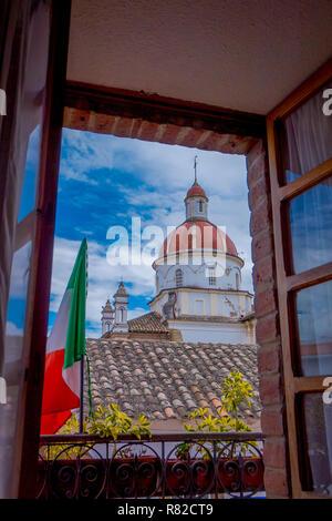 COTACACHI, ECUADOR, NOVEMBER 06, 2018: Outdoor view of Matrix Cathedral, picture taken through a window in the city of Cotacachi Ecuador - Stock Photo