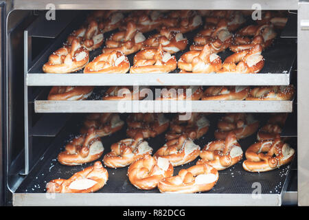 Sweet biscuits biscuit rolls cookies on baking pan hot out of the oven - Stock Photo