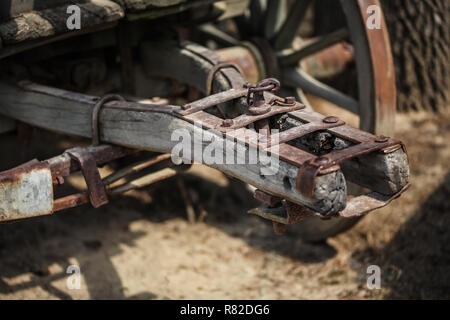 Detail on old rusty wooden wagon connecting mechanism. - Stock Photo