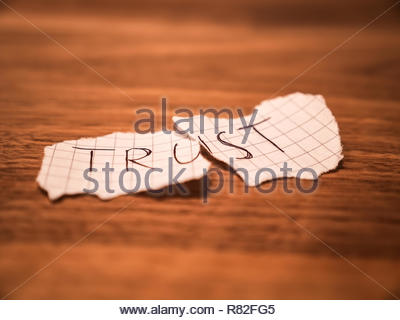 No trust handwritten teared up peace of paper on a table after cheating - Stock Photo