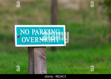 No parking overnight sign - Stock Photo