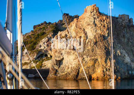 """Rocks of the Aeolian volcanic island """"Vulcano"""" as seen from a yacht deck. Sailing in Italy. - Stock Photo"""