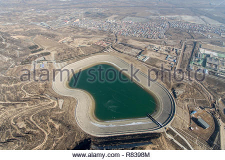 Taiyuan, China. 12th Dec, 2018. An artificial lake was filled with water in one night because of leakage of a water conservancy facilities in Taiyuan, Shanxi, China on 12 December 2018.(Photo by TPG/CNS) Credit: TopPhoto/Alamy Live News - Stock Photo
