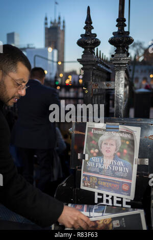 As the vote of no confidence for Prime Minister Theresa May's leadership in the Conservative Party occurs because of her handling of the Brexit deal with the EU, her face and a headline quote referring to Margaret Thatcher appears on the front page of the London Evening Standard at the entrance of Westminster tube station opposite Parliament in Westminster, on 12th December 2018, in London, England. - Stock Photo