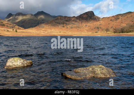 Blea Tarn in the English Lake District, looking towards the Langdales in late autumn / early winterCumbria, UK. - Stock Photo