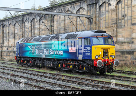A British Rail Class 57 diesel electric locomotive stabled at Carlisle train station.The Class 57 is a rebuilt version of the Class 47 - Stock Photo