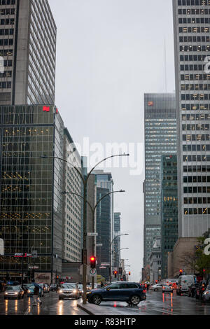 MONTREAL, CANADA - NOVEMBER 6, 2018: Business skyscrapers in the dowtown of Montreal, Quebec, on a rainy day, taken on Rene Levesque Boulevard in the  - Stock Photo