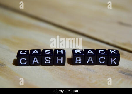 Cash back written on wooden blocks. education and motivation concepts. Cross processed image on Wooden Background - Stock Photo