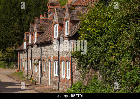 A row of traditional brick and flint cottages in the village of Hambleden, Buckinghamshire - Stock Photo