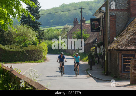 Cyclists in a country lane in the village of Fingest, Buckinghamshire - Stock Photo