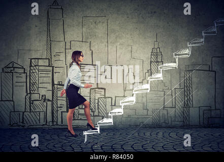 Side view of young businesswoman climbing career ladder against cityscape being professional real estate agent - Stock Photo