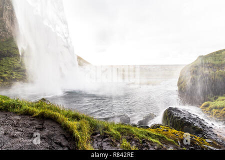 View from behind of scenic Seljalandsfoss, ring road Iceland - Stock Photo