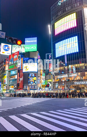 Pedestrian at traffic light on Shibuya Street. Shibuya Crossing is one of the busiest crosswalks in the world. - Stock Photo