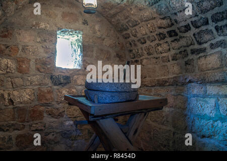 Village Njegusi, Montenegro - Antique millstone in the birth house of Petar II Petrovic Njegos (1813-1851) Montenegrin philosopher, poet and ruler - Stock Photo