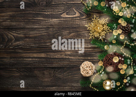 Christmas background with candle and decorations on dark wooden  - Stock Photo